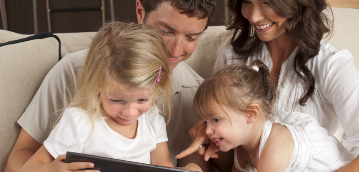 Happy family looking at a digital tablet